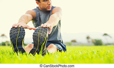 jonge man, stretching, voor, oefening