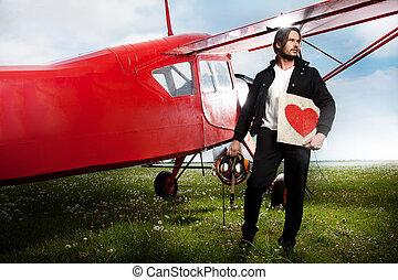 jonge, mooi, man, het poseren, naast, vliegtuig