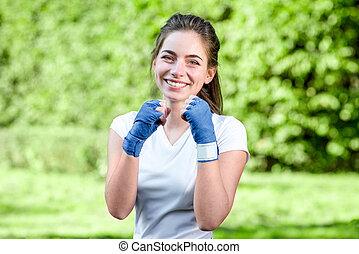 jonge, sporten vrouw, in het park