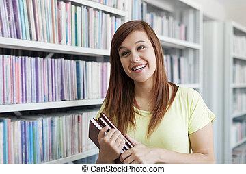 jonge, student, meisje, lachen, in, bibliotheek