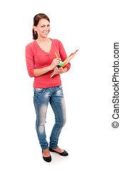 jonge, student, meisje, vervaardiging opmerkingen, in, aantekenboekje, vrijstaand, op wit, achtergrond