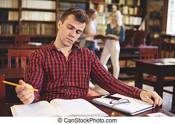 jonge, student, studerend , in, bibliotheek