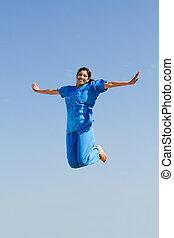 jonge, verpleegkundige, het springen in, lucht