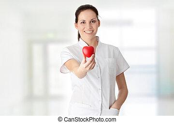 jonge, verpleegkundige, met, hart, in, haar, hand