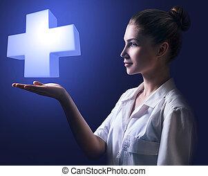 jonge vrouw , arts, vasthouden, groot, witte , cross.