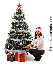 jonge vrouw , dichtbij, kerstboom, met, kadootjes