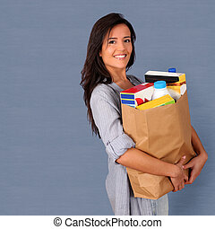 jonge vrouw , dragende zak, van, kruidenierswinkel
