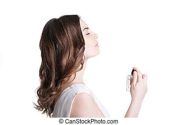 jonge vrouw , het verstuiven, de, parfum