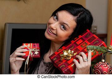 jonge vrouw , met, de giften van kerstmis