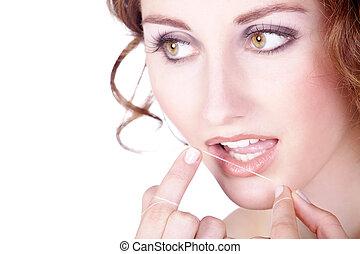jonge vrouw , met, dentale floss