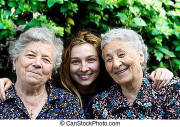 jonge vrouw , met, twee, senior, dames