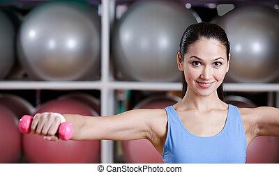 jonge vrouw , oefeningen, met, dumbbells