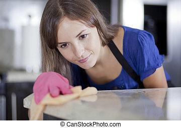 jonge vrouw , poetsen, de, keuken