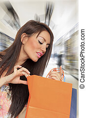 jonge vrouw , vasthouden, het winkelen zakken