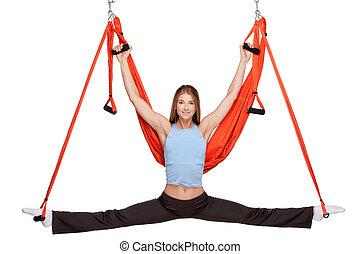jonge vrouw , vervaardiging, antigravity, yoga, oefeningen,...