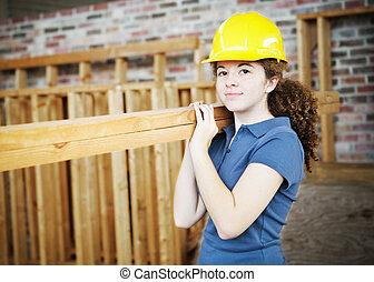 jonge, vrouwlijk, de arbeider van de bouw