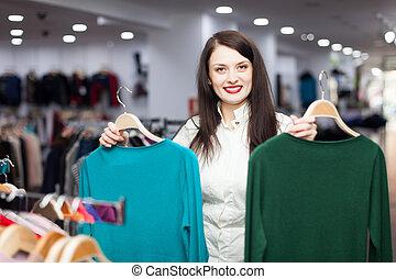 jonge, vrouwlijk, koper, met, truien