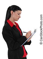 jonge, werknemer, schrijvende , op, een, notepad