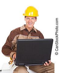 jonge, werktuigkundige, vasthouden, draagbare computer