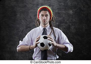 jonge, zakenman, met, een, voetbal