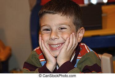jongen, het glimlachen