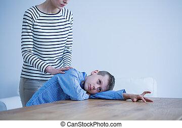jongen, het leggen, autisme, tafel