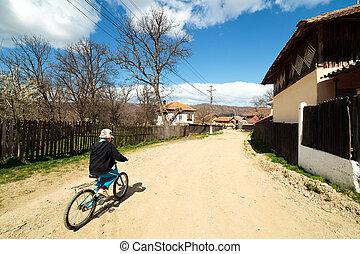 jongen, rijden van een bike, op, landelijke straat