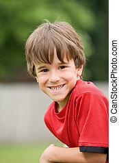 jongetje, het glimlachen