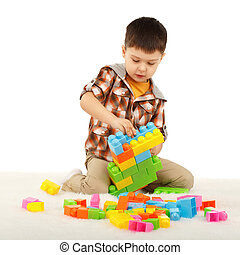 jongetje, spelend, met, ontwerper, op de vloer