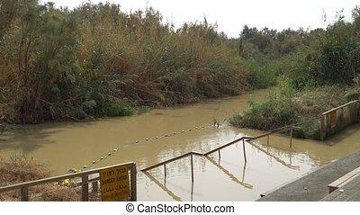 Jordan River, Israel. Yardenit Baptismal Site. River where Jesus of Nazareth was baptized by John the Baptist. The border between Jordan and Israel