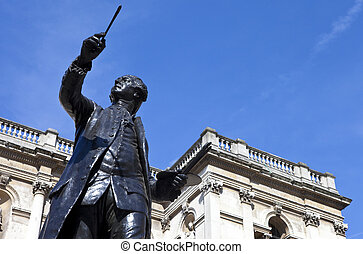 Statue of English painter Joshua Reynolds situated at Burlington House which houses the Royal Academy of Art in London.