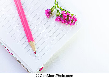 jotter, pencil and flower - empty note book, pink pencil and...