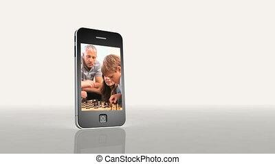 jouant échecs, vidéos, famille