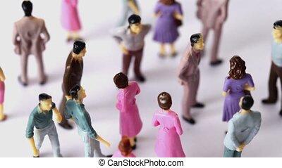 jouet, peint, hommes, quelques-uns, stand, brouiller, femmes