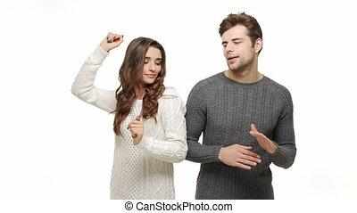 jouir de, danse, couple, jeune, ensemble, attraction., ralenti, amusement, sentiment, chandails, noël, célébrer