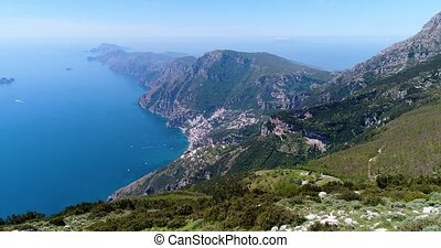 joung woman hiking in mountains above Amalfi coast in Italy