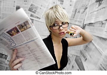 journalist - going to the movies: woman checking out movies...