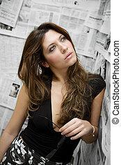 journalist - women at work: secretary stading against a...