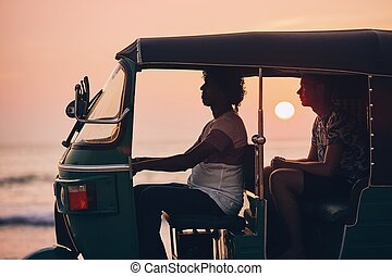 Journey by tuk tuk - Driver and passenger are traveling by...