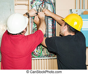 Journeyman Electricians Working - Journeyman and apprentice...