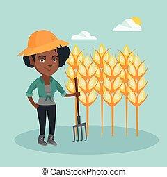 jovem, agricultor, ficar, em, um, campo, com, pitchfork.