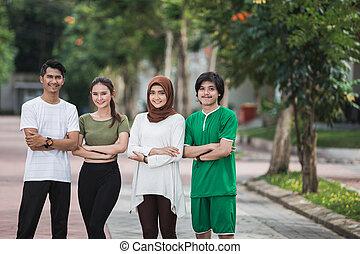 jovem, asiático, desporto, pessoas, braço cruzado