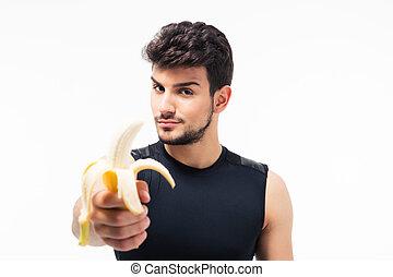 jovem, bonito, banana, segurando, homem