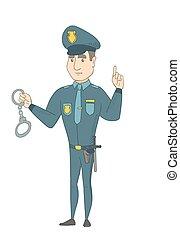 jovem, caucasiano, policial, segurando, handcuffs.