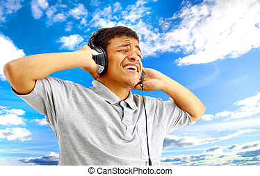 jovem, escutar música, feliz, cantando, homem