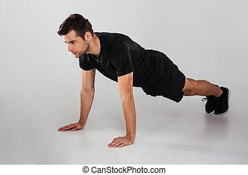jovem, esportes, homem, fazer, esportes, exercícios, isolado