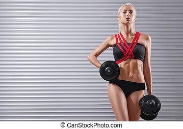 jovem, exercitar, ajustar, bonito, sportswoman, dumbbells