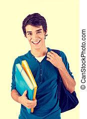 jovem, feliz, estudante, carregar, livros