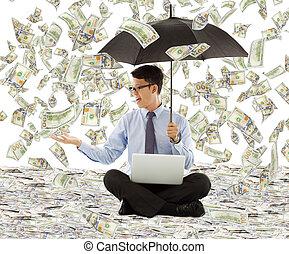 jovem, homem negócio, segurando, um, guarda-chuva, com, dólar, chuva
