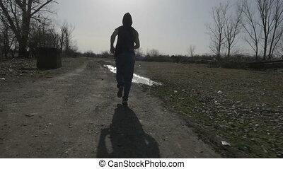 jovem, hooded, homem faz jogging, em, natureza, e, pular,...